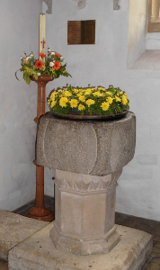 St Peter's font and paschal candle